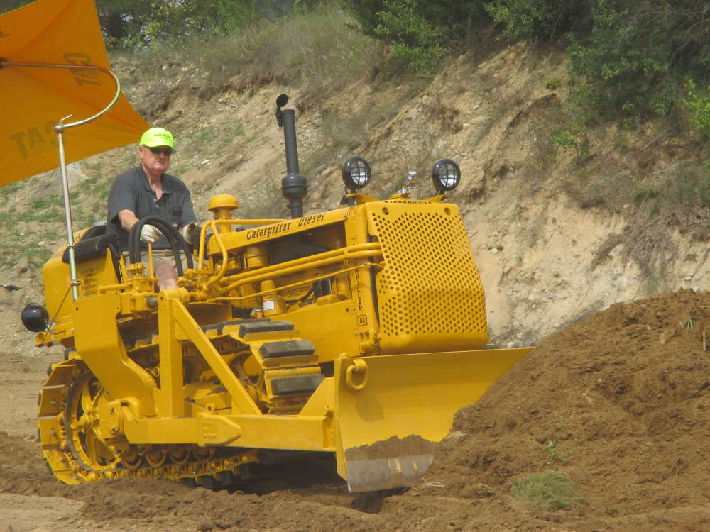 Jack McDevitt, president and CEO of McDevitt Trucks Inc. of Manchester, N.H., demonstrates his 1950 Caterpillar D2 earthmover.