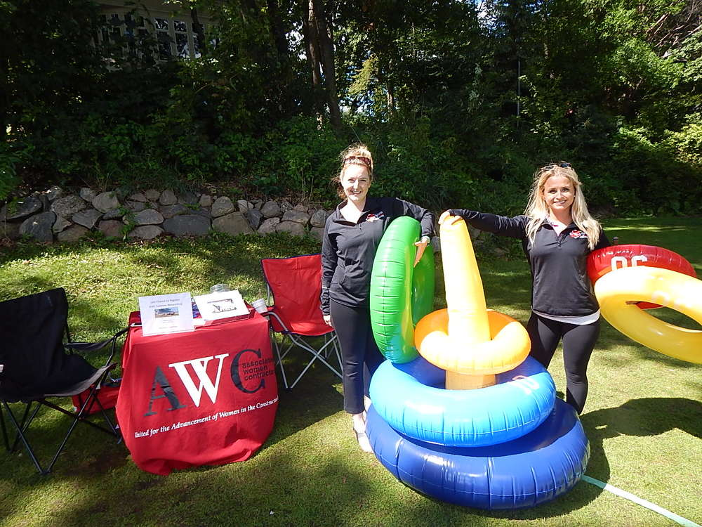 Janelle McCafferty (L), executive assistant, and Grace Dahlquist, administrative assistant, Association of Women Contractors, St. Paul, Minn., are ready to start the inflatable tube toss.