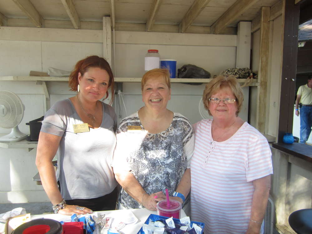 (L-R): Karri Lane, Mary Ellis Metz and Jackie Hritz, all of CAWGC, register attendees for the annual steak fry.