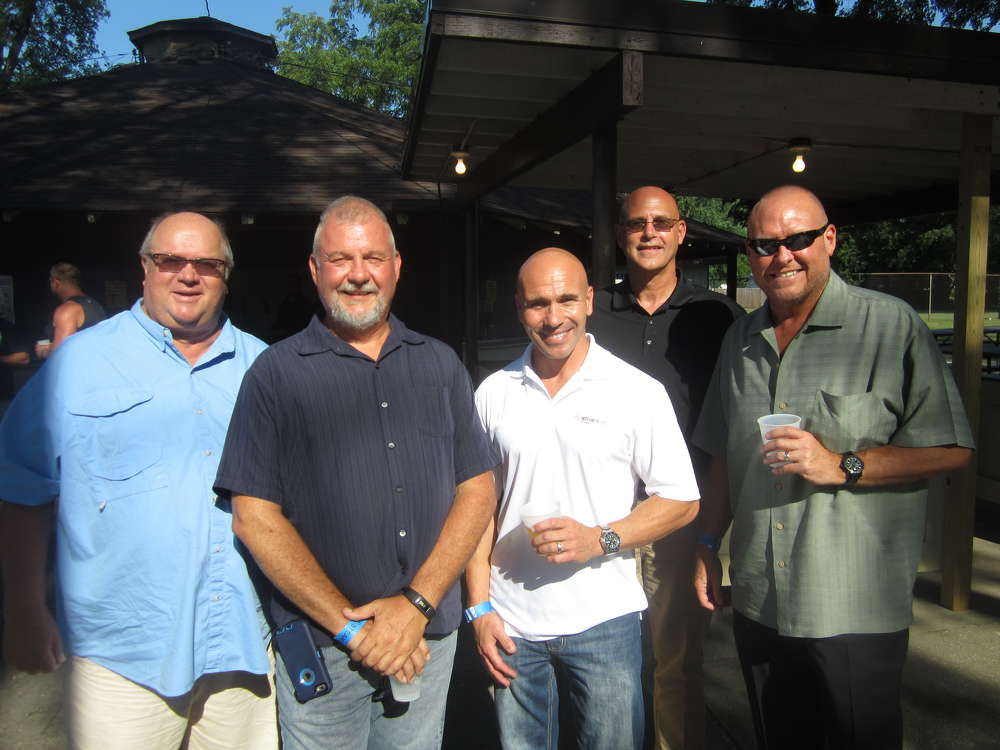 (L-R): Tony Mattingly, Patten Cat; Jody Foster, Welsch Ready Mix; Vince Blacha, Ritchie Bros. Auctioneers; Dave Donlon, Standard Equipment; and Jim Babcock, Teamsters Local 179, enjoy the annual steak fry in Joliet, Ill.