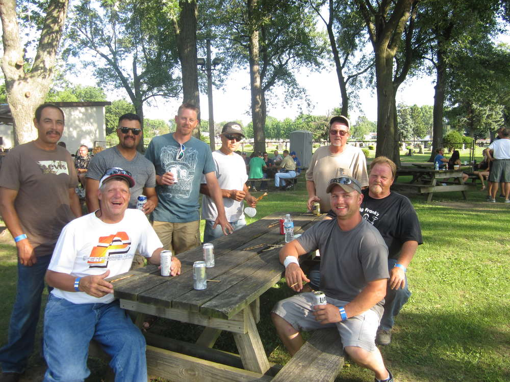The Baish Excavating Inc. team waits patiently for some steak.