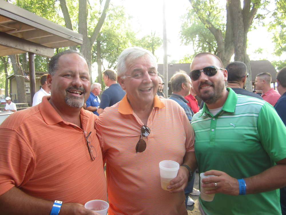(L-R): Kenny Sandeno, president of D Construction Inc., Bud Boyer also of D Construction and Brian Eggert, Welsch Ready Mix, share a few laughs at the steak fry.