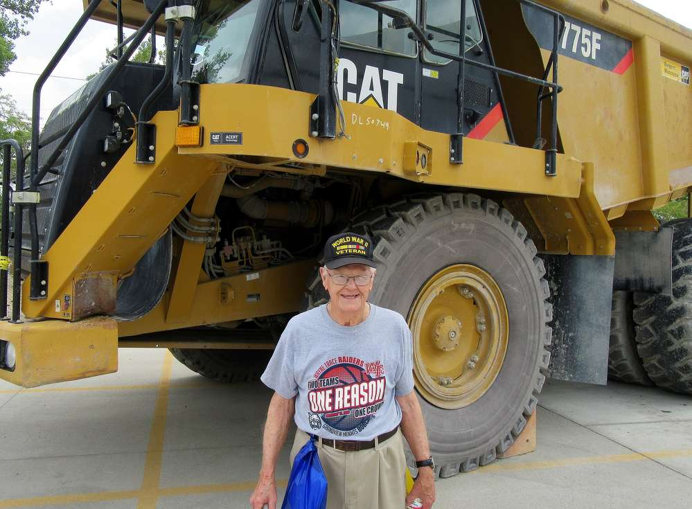 Major Klinger, who stopped in to see the Lafarge Paulding, Ohio, plant, was impressed with the size of this Cat 775F haul truck.