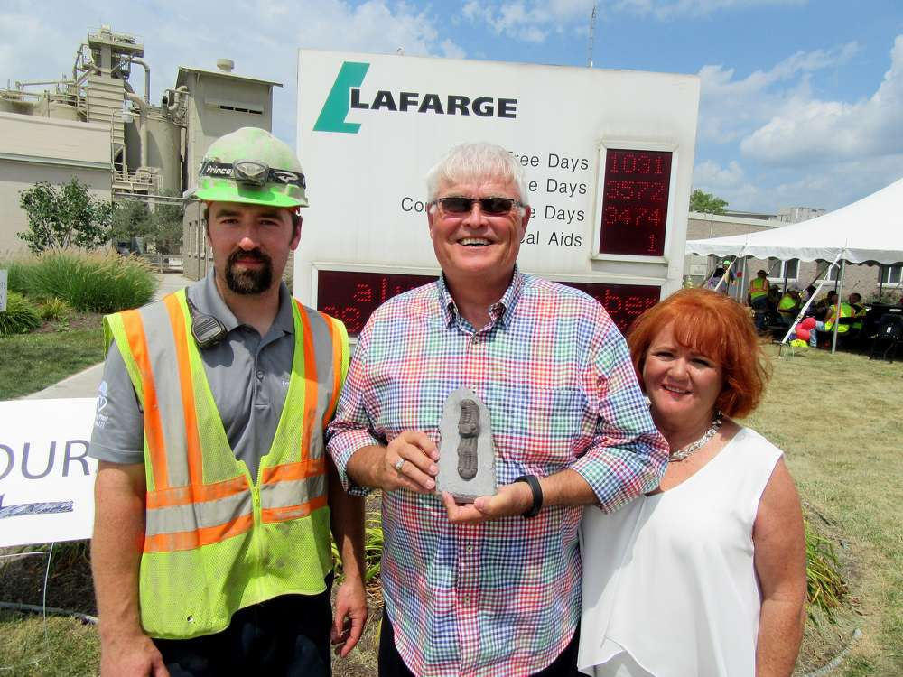 Ben Johnson, Lafarge, spoke with amateur fossil hunters Dave and Connie Mielke about some recent finds at the plant.
