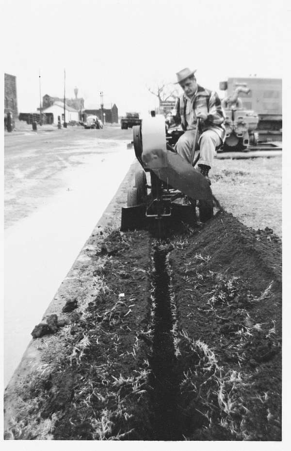Trenchless Technology photo. Ed Malzahn digs a 4-in. wide trench with his original trencher, the Model DW.