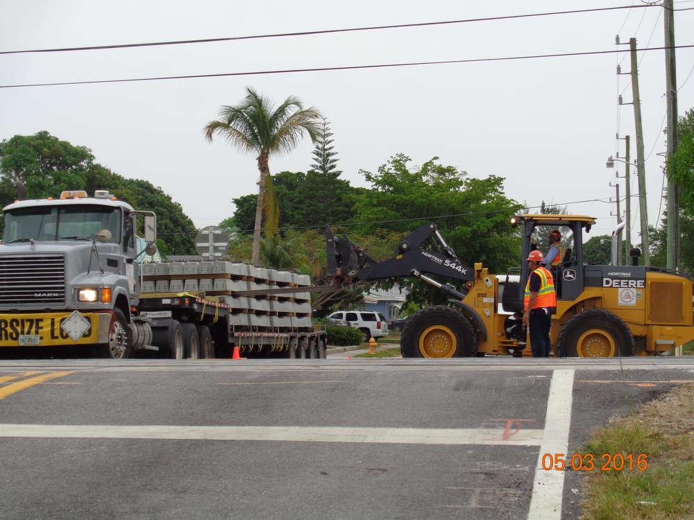 Crews unload crossties on the job site.