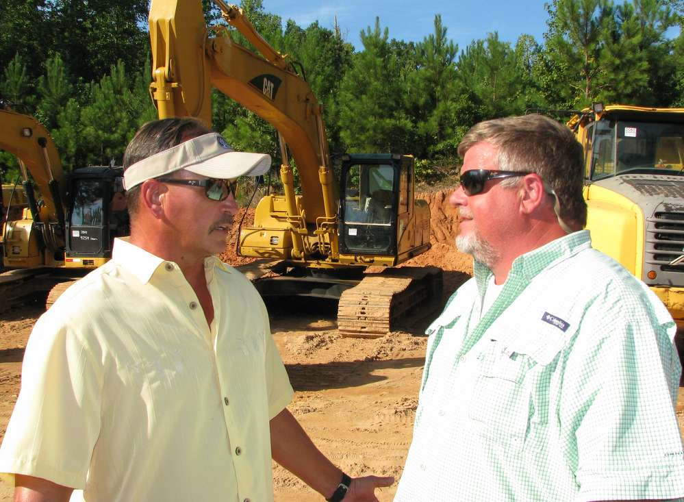 Tony Patterson (L) of Joey Martin Auctioneers and Brent Beverly of BTM Machinery, Charleston, S.C., discuss some of the machines about to go on the auction block.