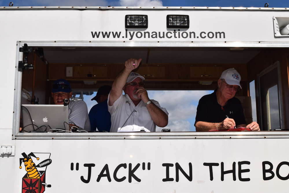 Jack Lyon keeps the auction running smoothly despite the heat.