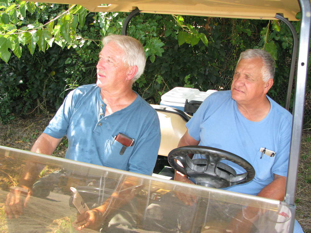 William Cheek (L) and Melvin Gibson, both of Gibson's Backhoe Service, Greenwood, S.C., beat the heat in the shade.