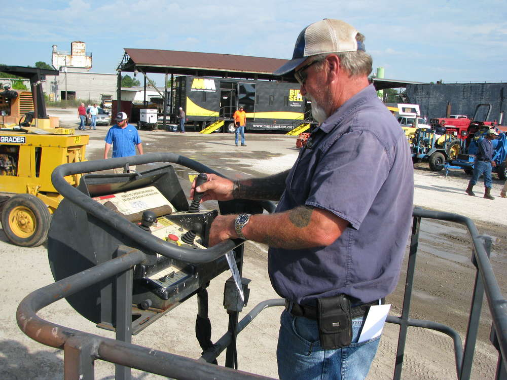 Cliff Croffer of Liberty Grading & Pipe, Lexington, Ga., looks over a Terex TB60 manlift.