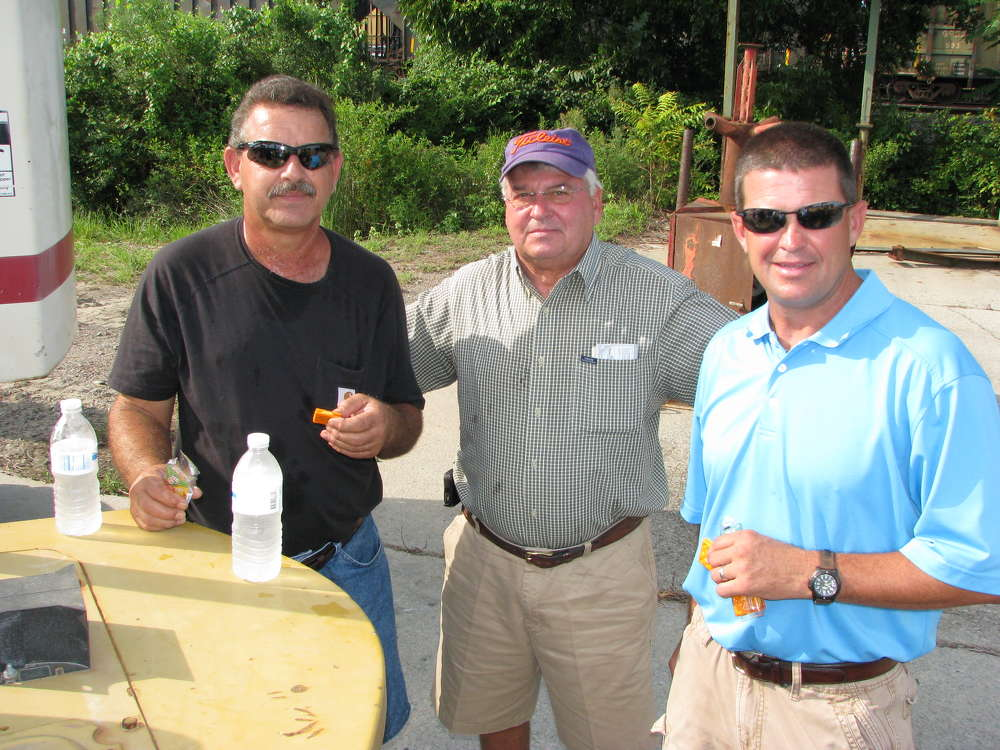 (L-R): Timmy Temples of Saluda, S.C., and Buddy Wannamaker and Dray Wannamaker of Persimmon Poultry, Saluda, S.C., take a snack break at the auction.