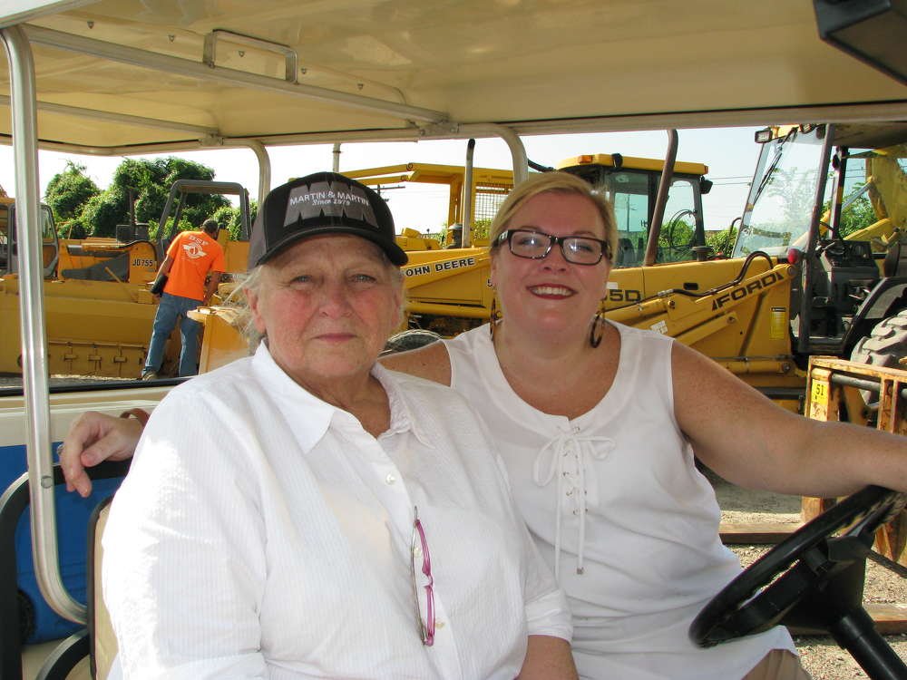 Debbie Martin (L) and Jennifer Upton of Martin & Martin Auctioneers cruise the lot before the sale.