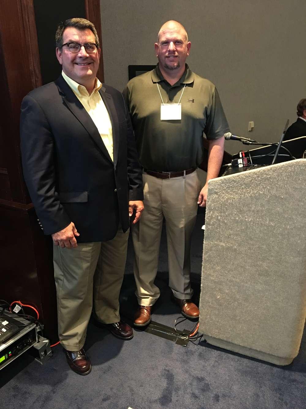 Joe Bateman (L), safety outreach director, ISRI, and Rob Jordan, ASC Construction Equipment, share a laugh at the meeting.