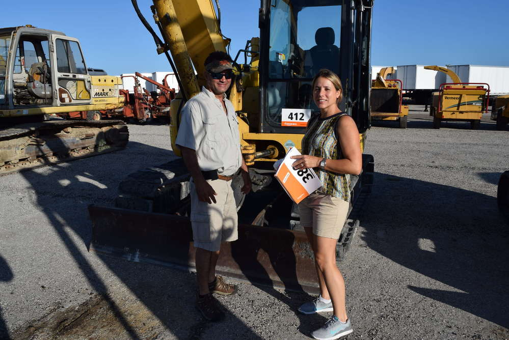Leo (L) and Gina Perez of Great American Development, West Palm Beach, Fla., look at a wide variety of equipment.