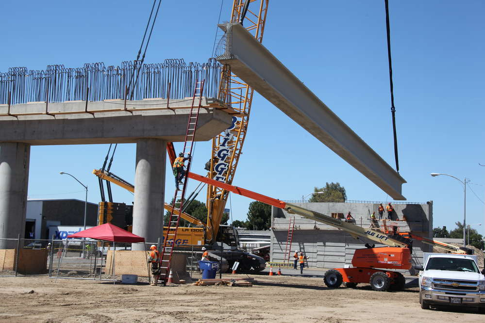 Construction crews placed the first of 42 massive steel and concrete girders on the new Tuolumne Street Bridge in downtown Fresno.