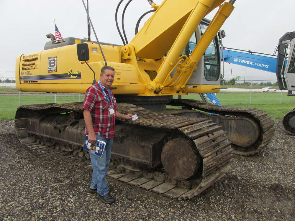 Glenn Sanderfer, Areaco Metal Recycling in Quinlan, Texas, takes a close look at this Kobelco 480 excavator to see if it would work in his scrap business.