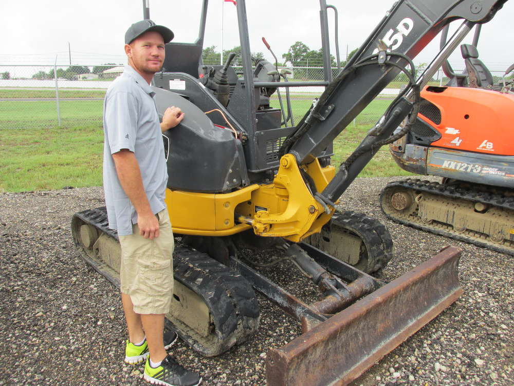 Matt Shelton of Legendary Dock Solutions in Tool, Texas, thinks this John Deere 35D excavator might be just what he needs to handle docks before they go in the water.