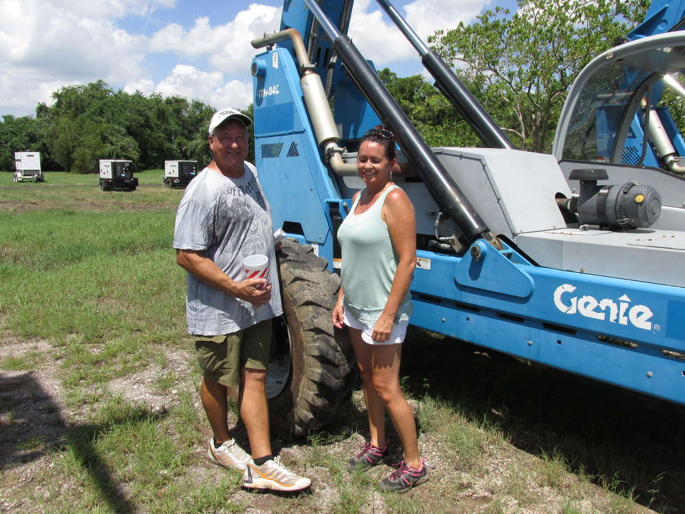 Allan (L) and Cari Mielsch of CLM of Texas, Magnolia, Texas, are sure this Genie GTH 842 high-lift is perfect for their next project.