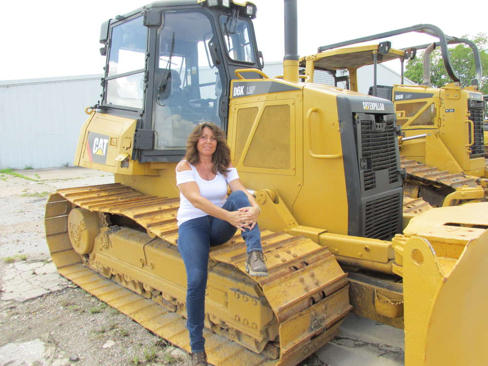 Penny Towner of Lazy River Ranch in Livingston, Texas, looks at this Cat D6K