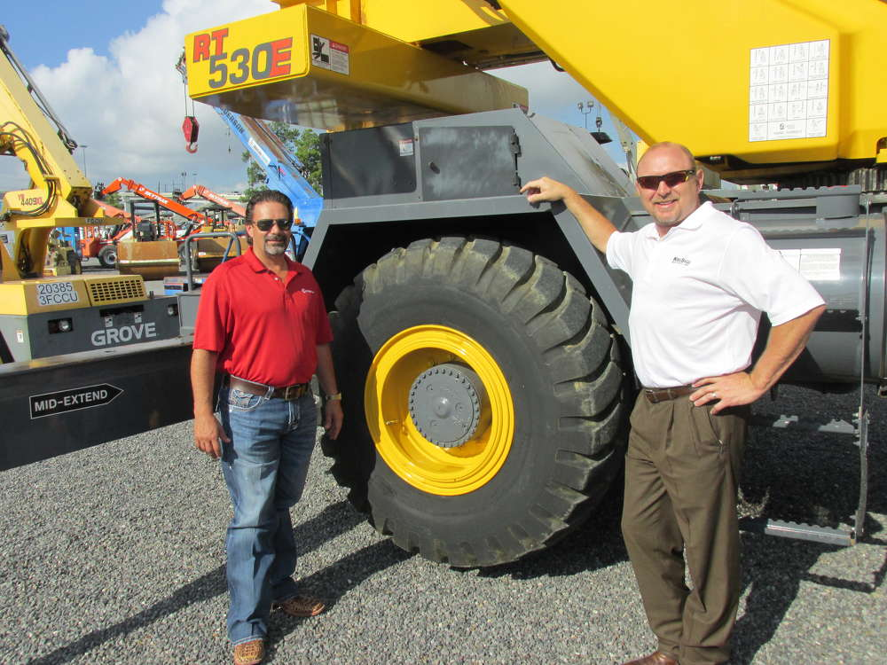 Jeff Cavaness (L) of Kirby-Smith Crane Division, Oklahoma City, Okla., and John Arterberry of Kirby-Smith Crane Division, Fort Worth, Texas, give this Grove RT 530E crane a complete physical.