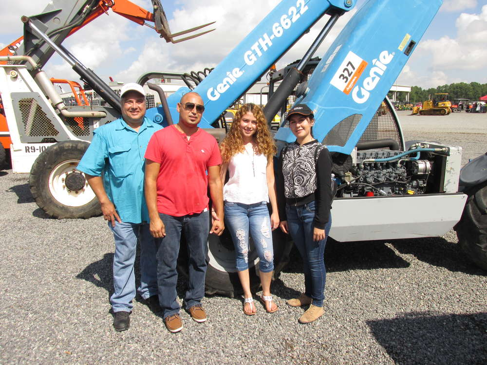 (L-R): Larry Vasques, Julio Enanorado, Nancy Lazo and Jennifer Calles of J. Construction in Conroe, Texas, have all decided that this Genie GTH 6622 high lift will be the machine they bid for.