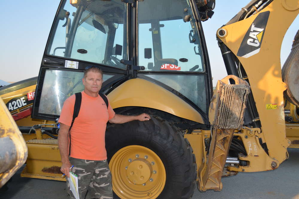 Rory Low, a homebuilder of Auburn, Calif., was shopping for a backhoe loader and this Cat 420E caught his eye.