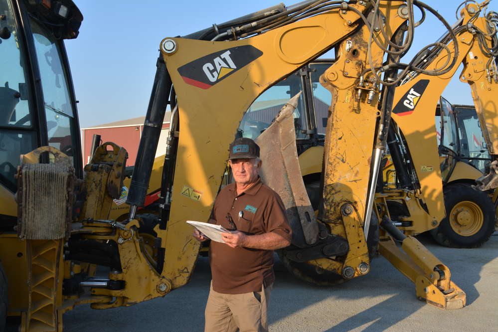 Larry Gaylor, GL Gaylor Construction of Indio, Calif., inspected the long line of backhoe loaders including this Cat 420F.