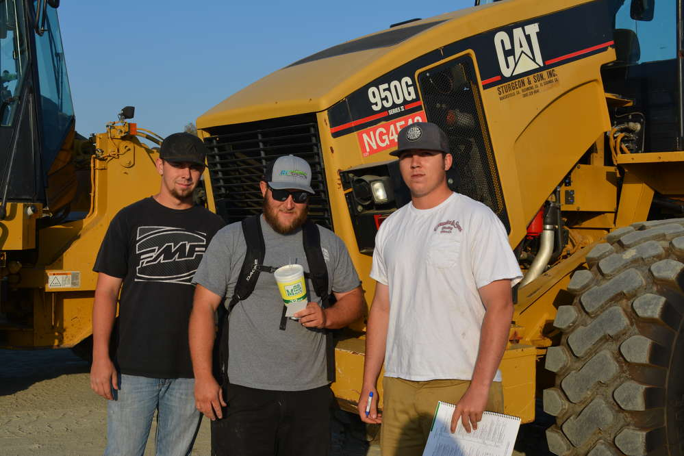 (L-R): Jack Hamilton, Brian Bartlett and Jacob Stuart, all of Bartlett Construction, Porterville, Calif., were browsing the huge selection of wheel loaders, including this Cat 950G.