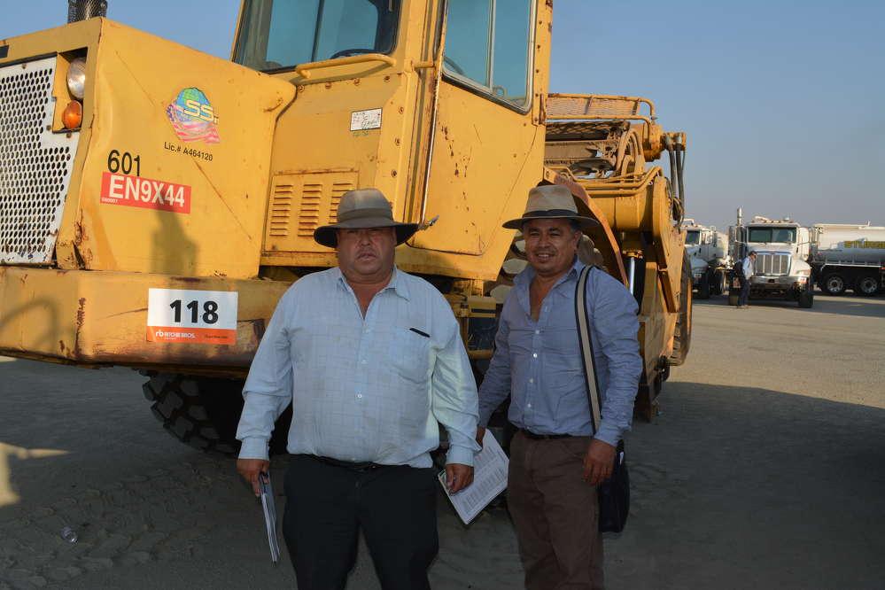 This Cat 601 scraper caught the attention of  Ubaldo Martin (L) and Soto Bernardino of Legacy Produce, San Bruno, Calif.