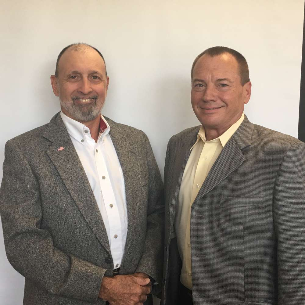 Mark Stapp (L) and Wayne Martin are now sales managers of Caron Compactor Co.