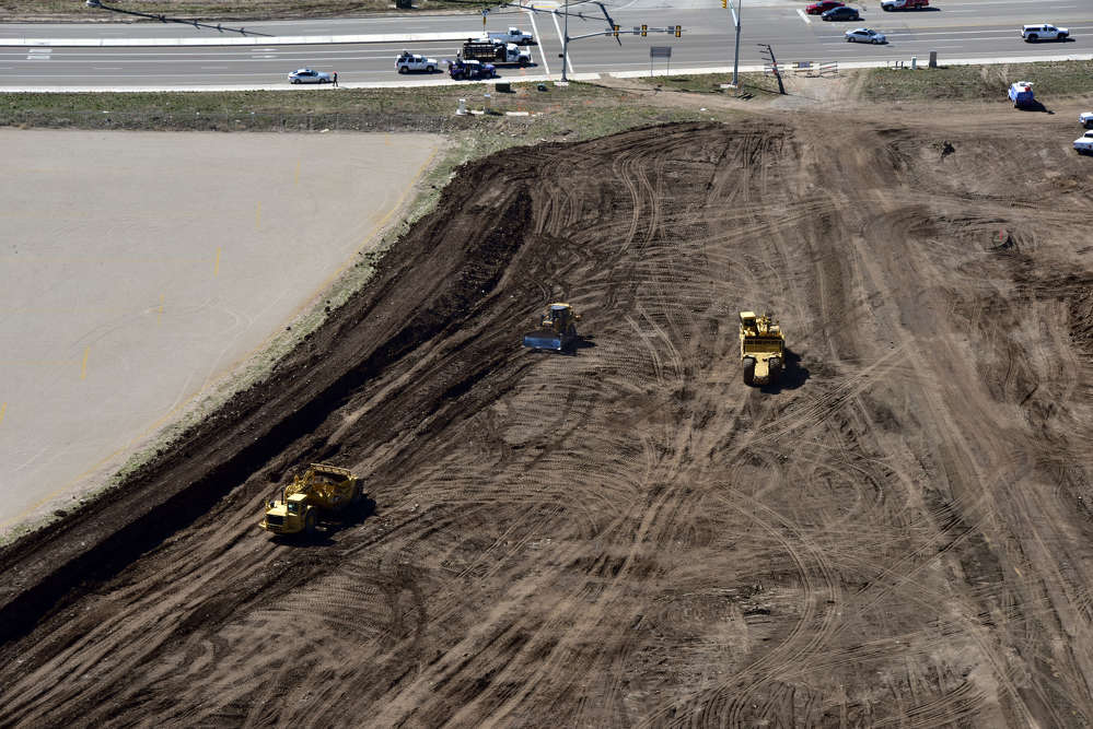 Nielson Construction - Staker Parson photo. Some sections also will include two-lane frontage roads on both sides of the freeway.