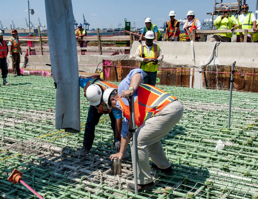 New York Wheel LLC photo. Crews dropped a time capsule into the final pour of concrete. Instructions are for the capsule to remain buried in the cement until 2646, which is 630 years from now — one year for each foot of the wheel's height.
