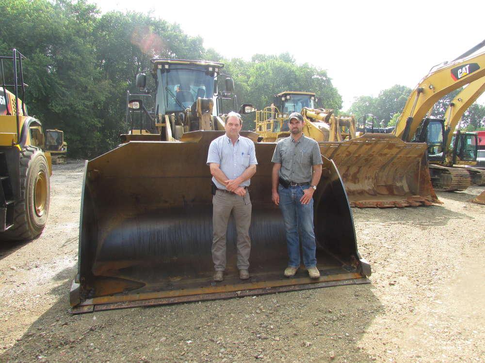 Barry (L) and Jon Baker, A-Del Construction, Newark, Del., attend the sale.
