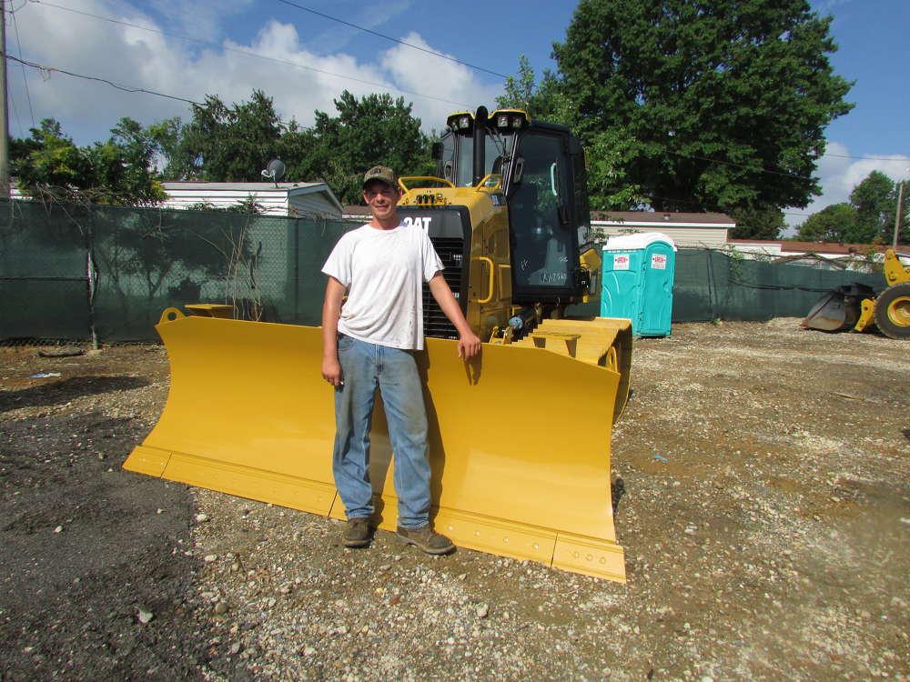Shane Baldwin, Carrow Construction, Newark, Del., looks over this Cat D5K2 track-type tractor.