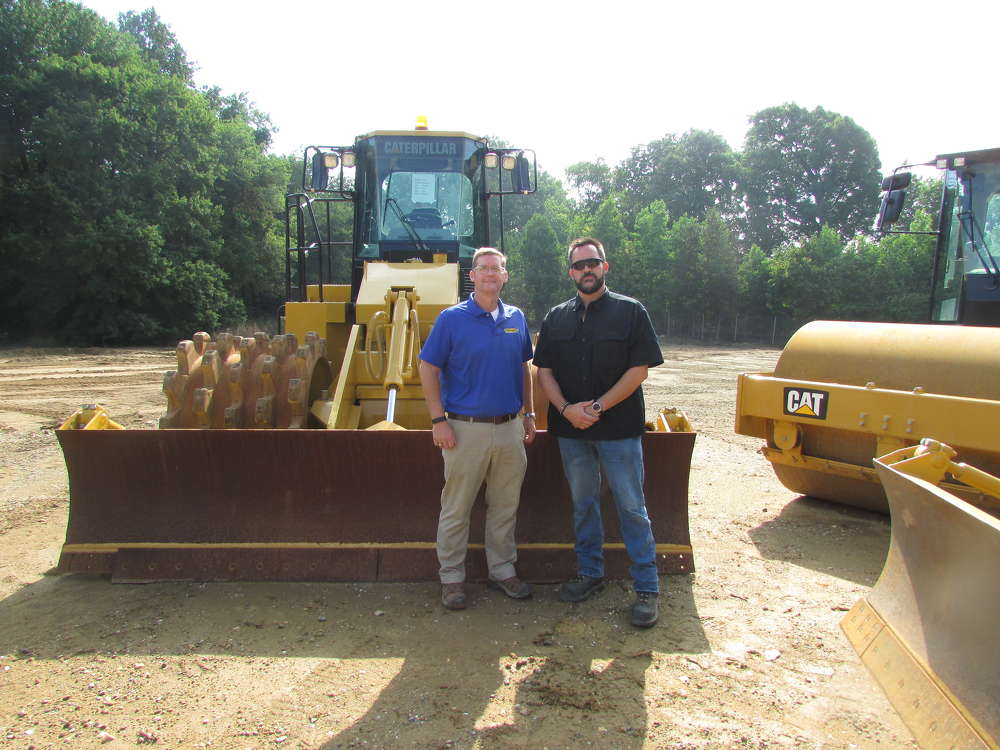Patrick Kerns (L), regional manager of Ransome CAT, speaks with Peter Criscuolo, Greggo and Ferrara Group, New Castle, Del., about this Cat 815F2 soil compactor.