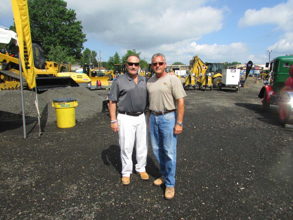 Bruce Evans (L), Ransome CAT, welcomes Mike Miklus, Mike Miklus Inc., Newark, Del., to the sale.