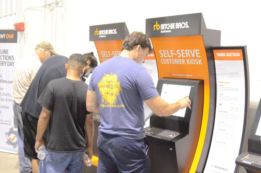 The self-serve customer kiosks were kept busy during the auction.