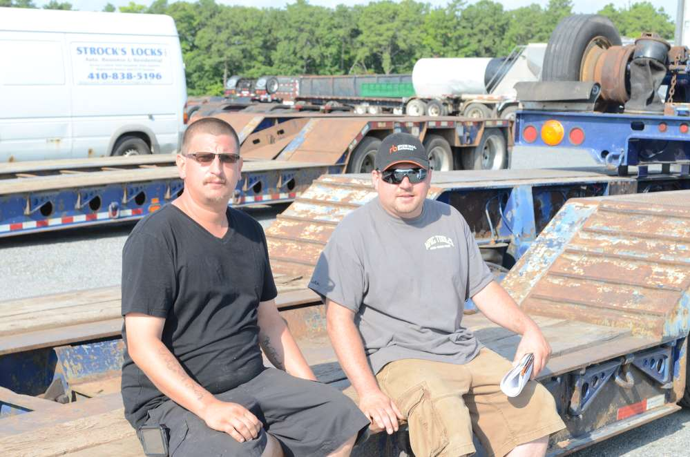 Kevin Waltz (L) and Eric Snider, both independent contractors from Dover, Del., take a quick break.