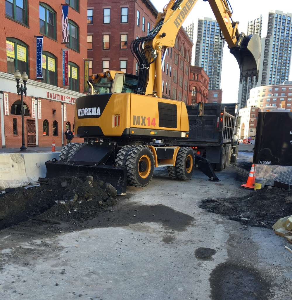 The Hydrema MX14 wheeled excavator is able to comfortably operate on Causeway street in downtown Boston.