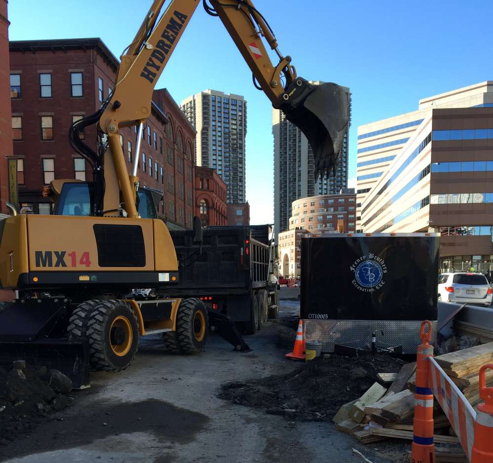The notorious narrow, congested streets of Boston are no match for a Hydrema compact wheeled excavator.