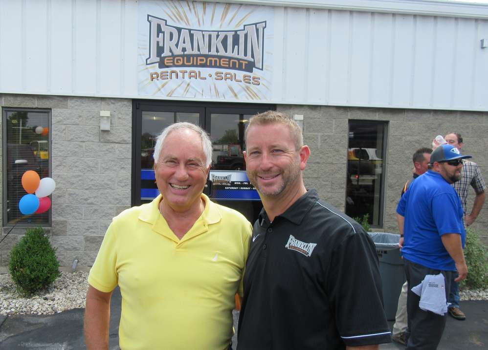 Ron Butts (L), Skyjack territory manager, joins Tony Repeta, Franklin Equipment, to help celebrate the Dayton branch grand opening.