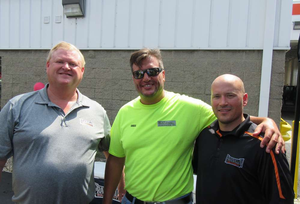 (L-R): Troy Gabriel, president of Franklin Equipment, and Zach Keller, sales representative of Franklin Equipment, welcome Danny Couch of Select Services to the grand opening event.