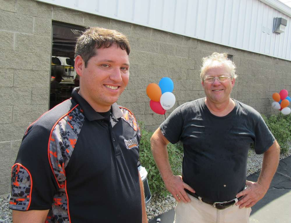 Rob Maley (L), Franklin Equipment, spoke with Bob Lloyd of Four Seasons Contractors at the grand opening event.