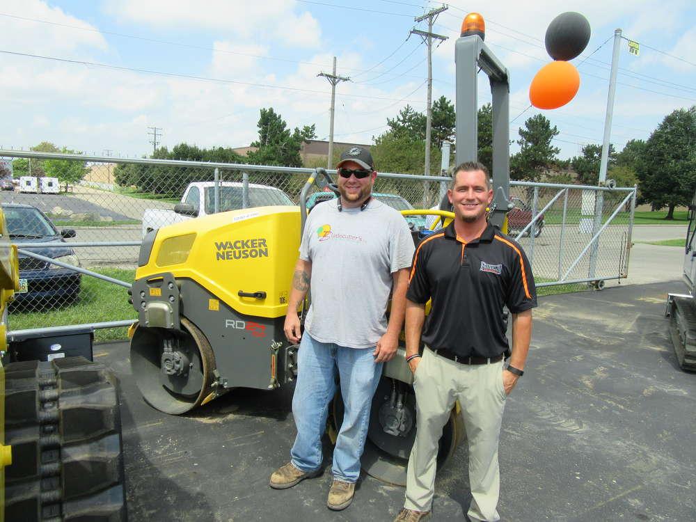 Matt Moon of Blade Cutters checks out the Wacker Neuson equipment with Cliff Dennis of Franklin Equipment.