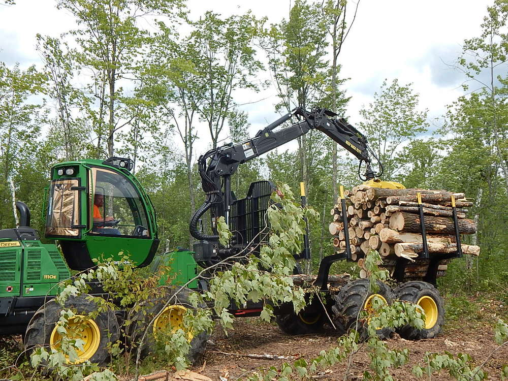 The operator demos this John Deere 1110E forwarder.