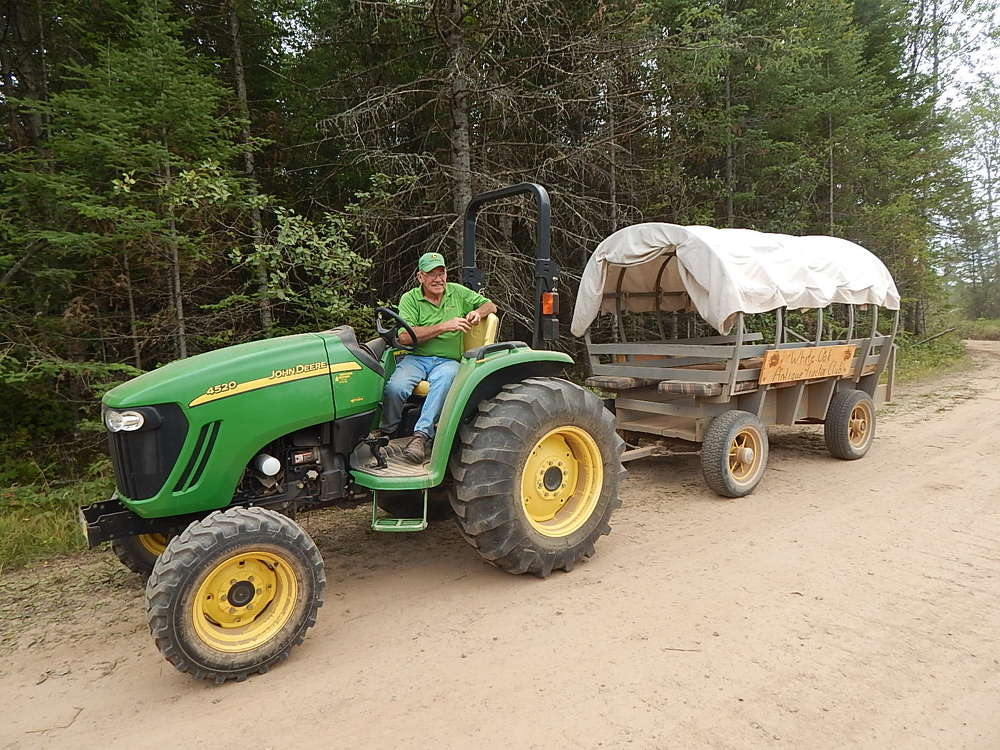 Tom Shannon, a retired Nortrax employee, worked for the company for 43 years. He drove attendees to the demo area using his 4520 John Deere compact tractor.