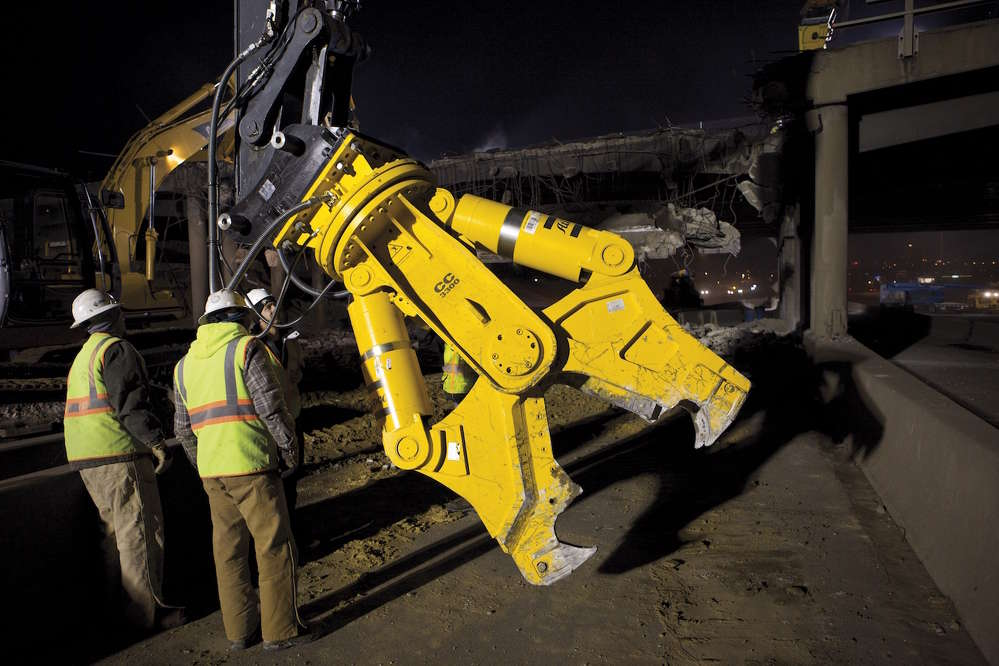 The Atlas Copco Combi Cutter works to cut rebar and demolish concrete during a bridge project in Colorado.