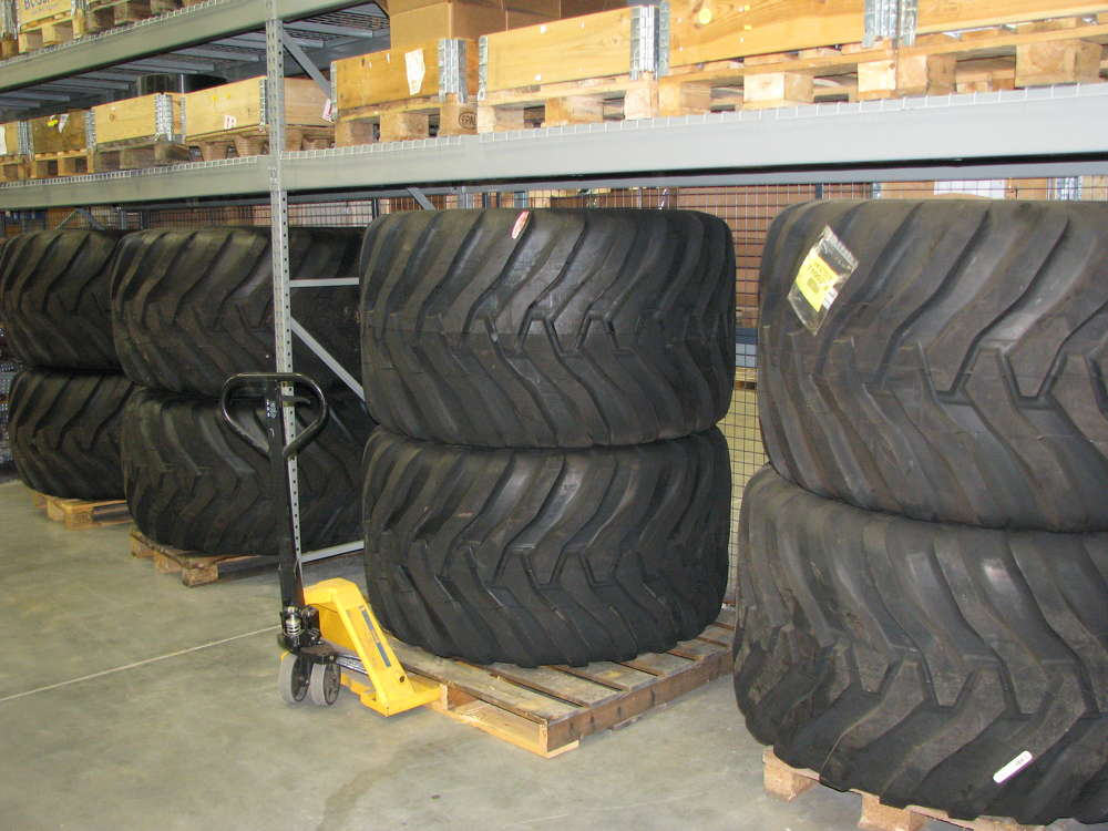 Off-road truck tires for all Hydrema models are stocked in the parts warehousing area.