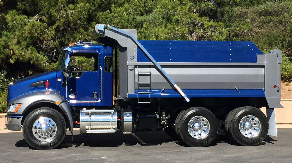 The Kenworth T370 is adding a durable straight steel channel bumper, larger size 385/65R22.5 steer tires, and rugged, molded thermoplastic fender extensions to benefit vocational customers.