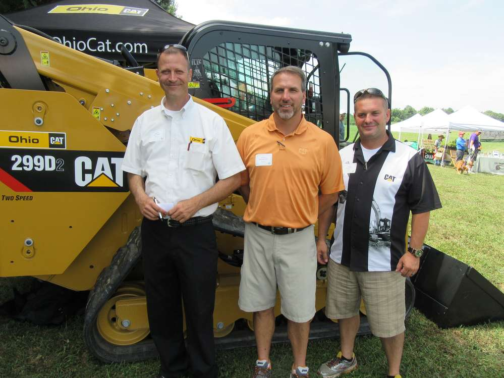 (L-R):?Art Westfall, Brian Speelman and Brian Gillard, all of Ohio CAT, spoke with attendees about the show special on this Cat 299D2 compact track loader.